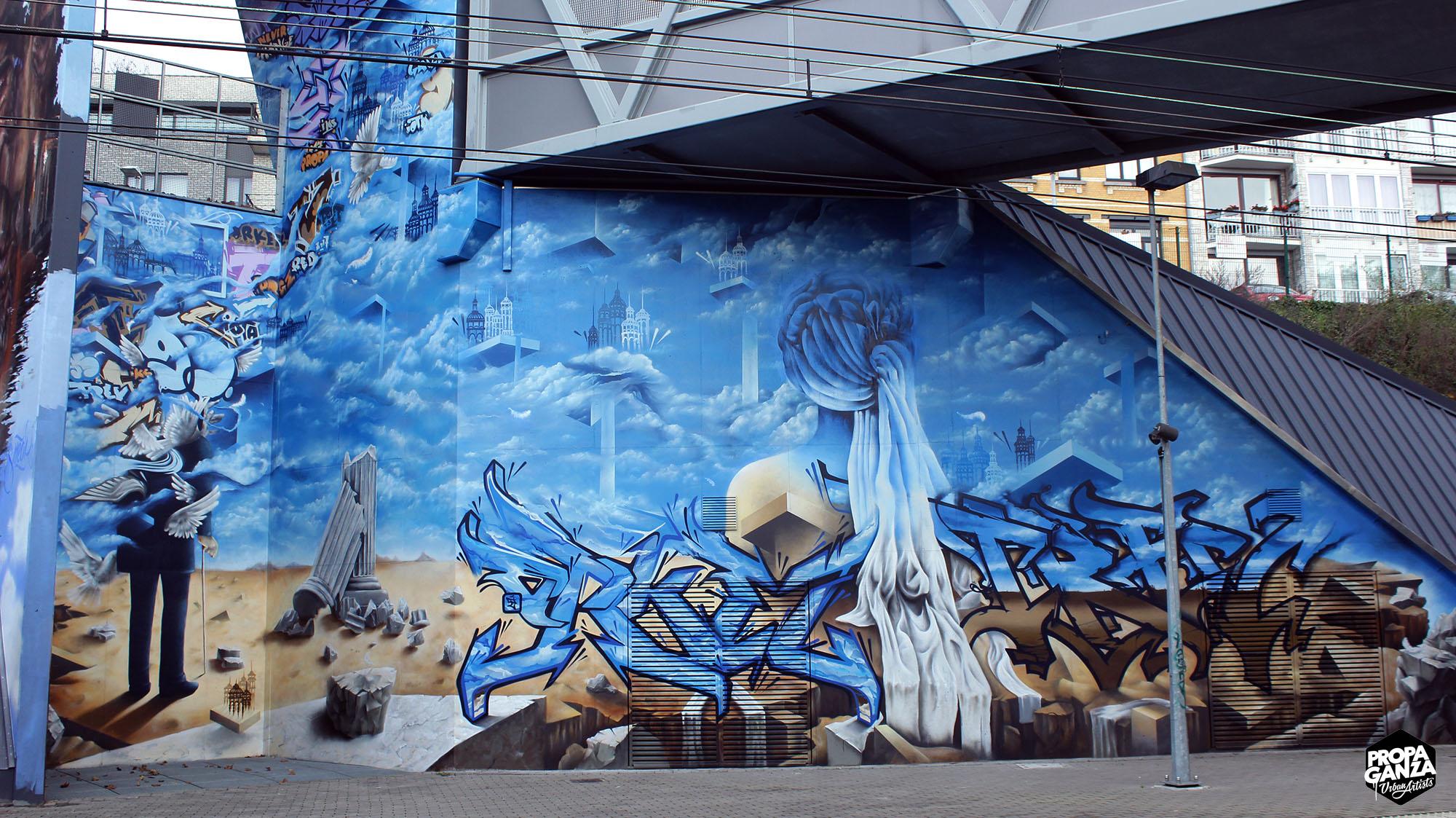 https://www.propaganza.be/wp-content/uploads/2016/05/propaganza-vivier-d-oie-uccle-belgium-graffiti-spraypaint-street-art-fresque-magritte-orkez-trevor-roubens-iota-piet-rodriguez-1.jpg