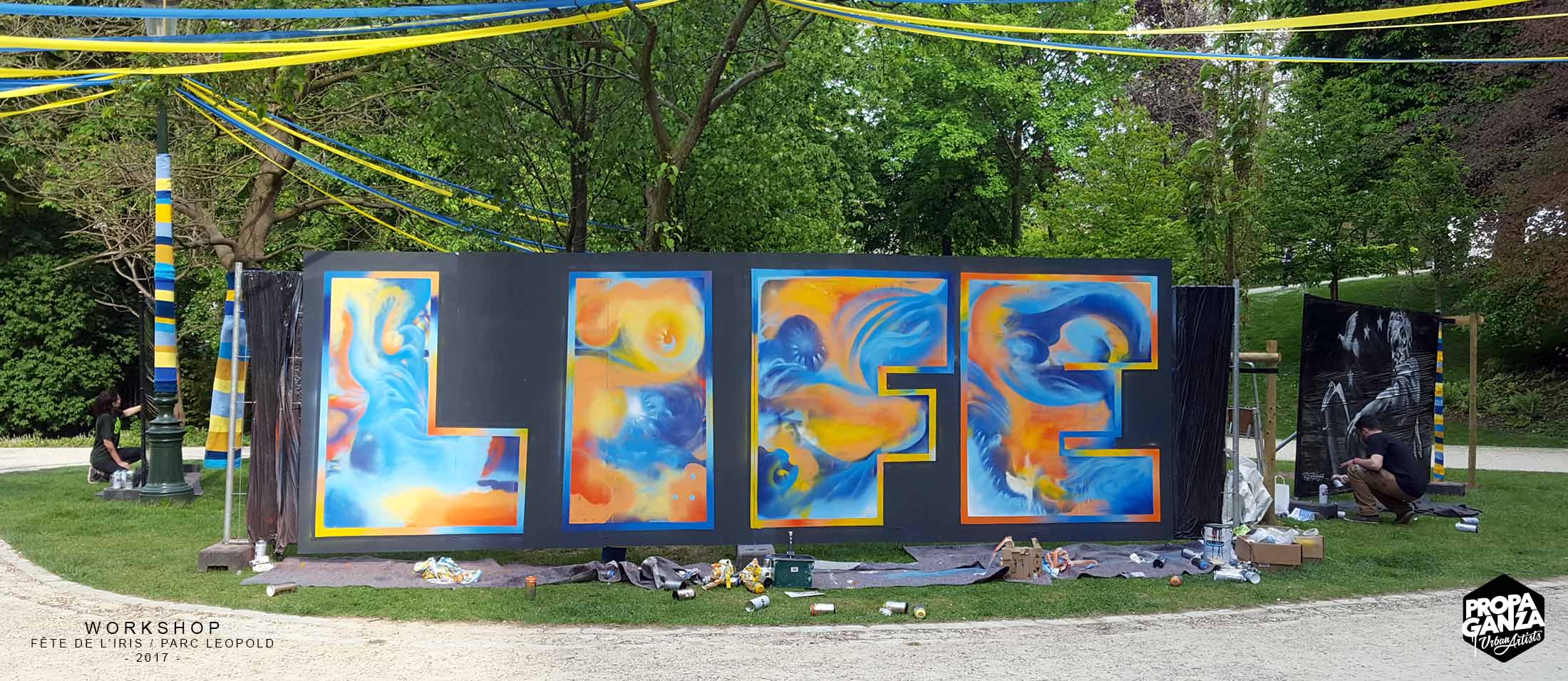 https://www.propaganza.be/wp-content/uploads/2019/04/Propaganza-graffiti-workshop-iris-leopold-parc-bruxelles-brussels-street-art-event-fresque-participative-2017.jpg